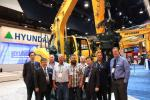 M.S. Kang (third from R), president of Hyundai Construction Equipment Americas, welcomes executives from Heavy Equipment Rental & Sales (HES) and its parent company, the Porter Group, to celebrate HES's purchase of eight Hyundai excavator models on display there. (L-R): J.Y. Moon, D.S. Kim, Darren Ralph, Robin Porter, Kent Porter, Simon Porter, M.S Kang, Hayden Porter, and Corey Rogers.